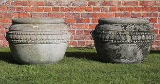 Pair of cast stone urns planters plant pots