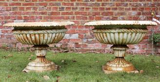 Antique classical pair of cast iron planters urns