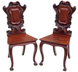 Antique pair of Victorian 19C carved mahogany hall chairs
