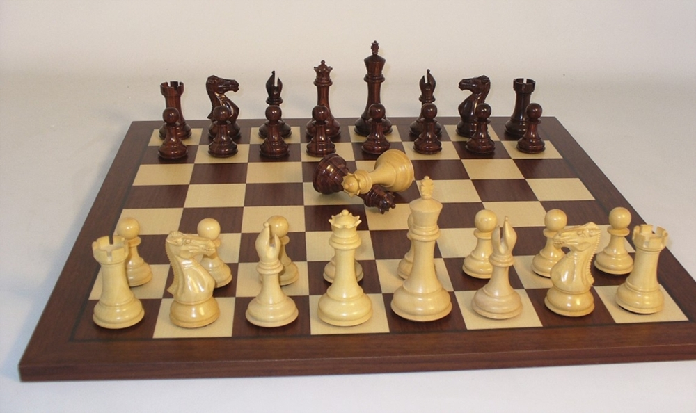 Rosewoood chess pieces on rosewood chess board