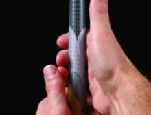 clear reminder grip showing correct hand placement.