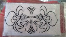 White head band with black studded cross.