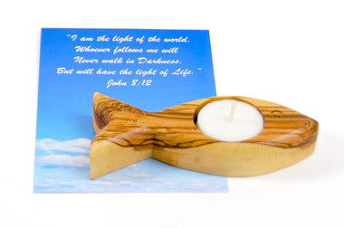 Single Olive Wood Fish Candle. Packed with Authentication Card and Bookmark.  The Fish shape is inspired by first century Christians who used the fish mark to distinguish friends from foes. When they met a stranger in the road, one would sometimes draw an arc of the simple fish outline in the dirt. If the stranger drew the other arc, both believers believed they were in good company.