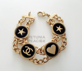 CHANEL BLACK ENAMEL LOGO, HEART & STAR BRACELET