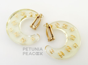 CHANEL CRESCENT SHAPED LOGO FILLED LUCITE EARRINGS