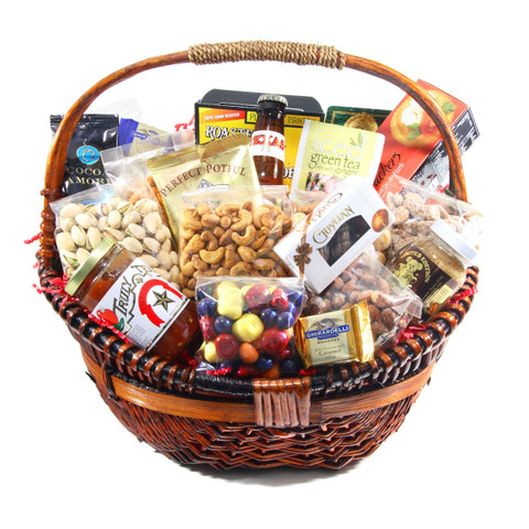 austiNuts Wicker Basket with Handle is Perfect for any occasion! Our Large Wicker Basket is filled with dry roasted savory nuts, delicious chocolates and gourmet food products. If wanting to make a lasting impression and show your appreciation, this basket will definitely do the job!  Contains: Deluxe Nut Mix, Cayenne Cashews, Pistachios in Shell, Praline Pecans, Smoked Almonds, South of the Border Mix, Ghirardelli Chocolate Squares, Toblerone Chocolate, Turin Kahlua Chocolates, United We Stand Truffle Bar, Manner Cream Filled Wafers, Limited Edition Pecan Honey Butter, Hombres Texas Chipotle Salsa, Turtle Island Cheddar Beer Soup, Tastes of the Southwest Beerbecue Rub, Bella Crema Gourmet Cappuccino, Cocoa Amore Instant Cocoa, Coffee Masters Gourmet Coffee, David Rio's Chai Tea, & Gourmet Village Gourmet Village Iced Tea Mix