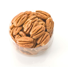 Dry roasted pecan halves in a clear container