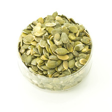Pumpkin Kernels in a clear container | Pumpkin Seeds