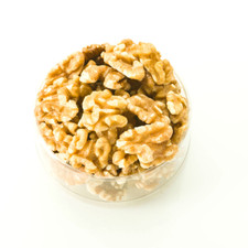 Raw Walnuts in a clear container