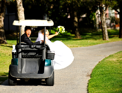 Couple in golf cart after wedding