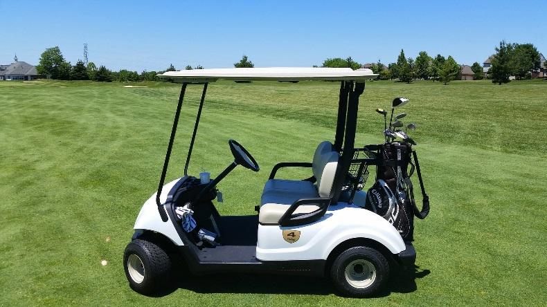 Empty golf cart on greens