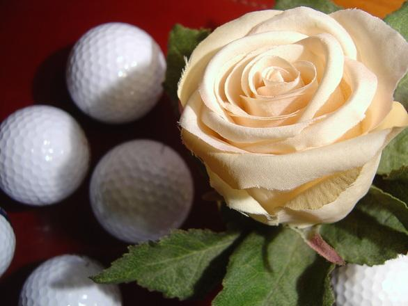 Golf balls with rose