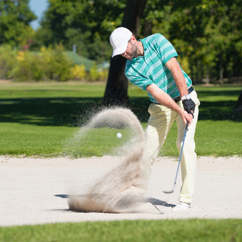 Golfer-hits-the-ball-out-of-sand-trap