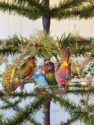 Four Birds Sitting on Elaborately Decorated Glass Horn Ornament