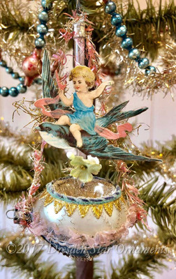 Reserved for Jennifer – Child Riding Swallow on Oval Ornament Rimmed with Pink and Silver Tinsel Garland