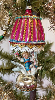 Reserved for Jennifer – Child Riding Dove on Pink Glass Lantern Ornament