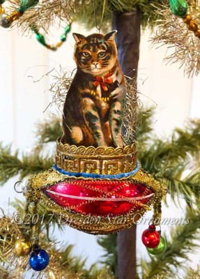 Calico Cat in Red and Gold Basket with Dangling Glass Balls