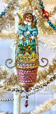 Snow Angel Wearing Chenille-Rimmed Blue Cloak in Elaborate in Antique Pink Molded Glass Basket