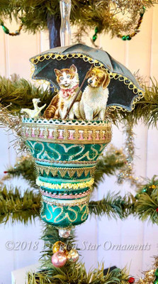 Reserved for Diana – Dog, Cat and Chick Trio with Umbrella on Beautiful Green Bell ornament