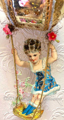 Fabulous Girl on Swing Hanging from Decorated Glass Ornament