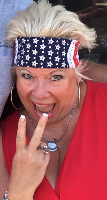 Bandana, American made flag loaded with Swarovski crystals, over 200 of them.  Red center in the stars surrounded by clear bling.  Check out all our stars and strips American Flag bandanas on line or swing on by our store in Red Wing, Minnesota