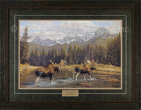 Two moose crossing a shallow river in a mountainous landscape