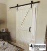 """British Brace Barn Door - painted white. Photo also shows our Antique Style 9"""" door pull."""
