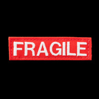 Fragile patch: red background, glow-in-the-dark white text