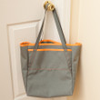 Topside Tote: foliage green with neon orange binding, and foliage green handles