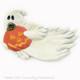 White Ghost holding carved Jack O'Lantern pumpkin tea bag holder or Halloween kitchen decor.