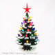 Little green ceramic Christmas tree with snow tip branches, color lights and red star
