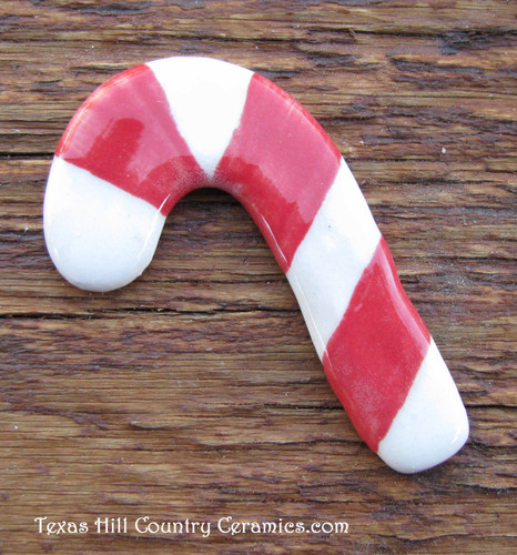 Red and white candy cane magnetic needle minder hand made in the USA.