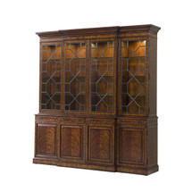 A flame mahogany breakfront library bookcase by Theodore Alexander