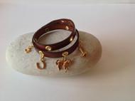 Double wrap gold charm bracelet