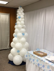 Another use of the column is to create Holiday trees.  This one is a snowy holiday tree with blue and silver balloon ornaments