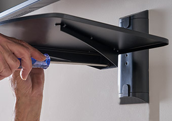 next, connect the shelf to the wall bracket, it's super easy