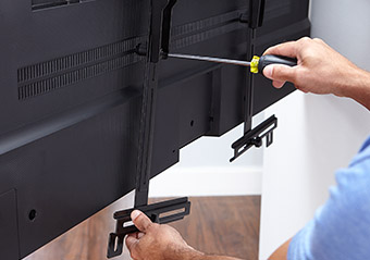 connect the sound bar mount brackets to the back of your flatscreen tv