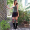 claire wearing cute skirt, boots and over the knee socks