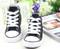 Black Converse style, canvas shoe front.