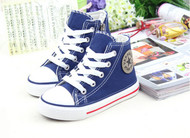 Blue Converse style, canvas shoe.