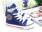 Blue Converse style, canvas shoe angle right.