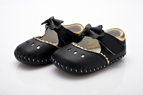 Baby Girls Black & Gold Soft Soled Shoe with a black bow.