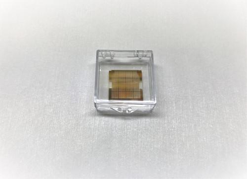 Large area MoS2 monolayers transferred onto nano electromechanical devices (NEMS)