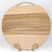 Round Wooden Cheese Board with Handle. Made of Tasmanian Sassafras it is very decorative and a perfect serving board for cheeses or snacks. A stainless steel handle completes it.