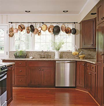 for those who use a plethora of pots and pans a pot rack that outlines the room may be the perfect option hanging below the wraparound ledge enables the