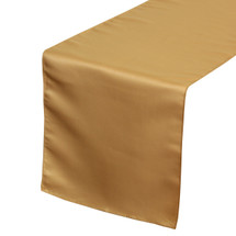14 x 108 inch Lamour Satin Table Runners in Gold on a white tablecloth