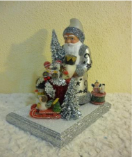 Schaller Santa in silver coat with toys display