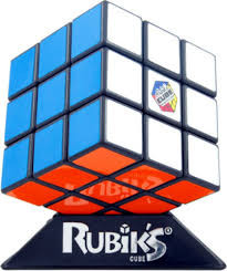 """In 1974 a Budapest Architecture Professor named Erno Rubik created an object that was not suppose to be possible. His solid cube twisted and turned - and still it did not break or fall apart.  With colourful stickers on its sides, the cube got scrambled and thus emerged the first """"Rubik's cube"""".  One of the most infuriating & engaging inventions ever conceived."""