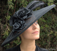 Black Kate's Hat in Sinamay Straw with Flowers and Feathers.