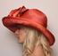 Cosmo Side View, Orange Derby Hat.